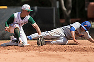 University of Miami second baseman Willy Escala puts University of Florida left fielder Austin Langworthy out on second base in the first inning of an NCAA baseball game at Alex Rodriguez Park in Miami, Florida, Sunday, February 25, 2018.