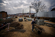 Construction of a retaining wall on the outskirts of Prishtina, near the old railroad tracks...Prishtina, Kosovo - Eve of one-year anniverary - February 16, 2009.