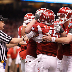 January 4, 2011; New Orleans, LA, USA;  Arkansas Razorbacks players celebrate with tight end D.J. Williams (45) after a two point conversion during the third quarter of the 2011 Sugar Bowl against the Ohio State Buckeyes at the Louisiana Superdome.  Mandatory Credit: Derick E. Hingle