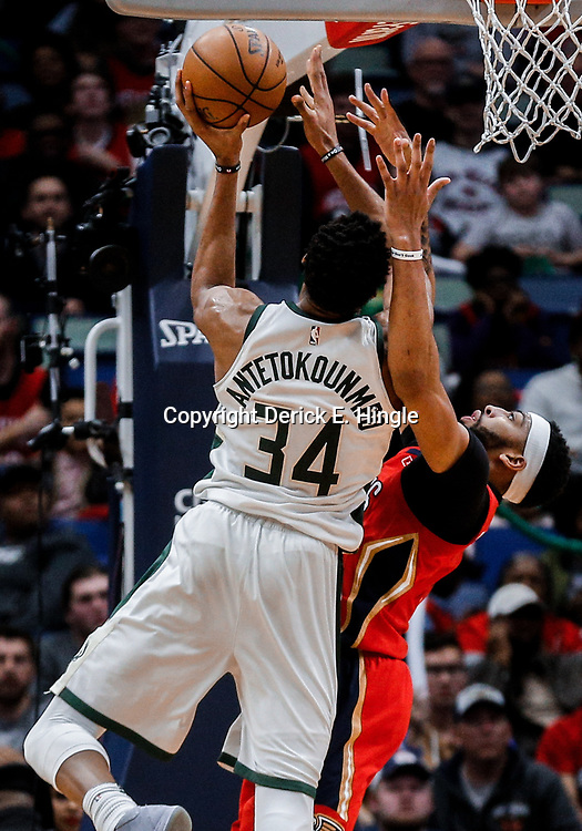 Dec 13, 2017; New Orleans, LA, USA; New Orleans Pelicans forward Anthony Davis (23) defends Milwaukee Bucks forward Giannis Antetokounmpo (34) during the second half at the Smoothie King Center. The Pelicans defeated the Bucks 115-108. Mandatory Credit: Derick E. Hingle-USA TODAY Sports
