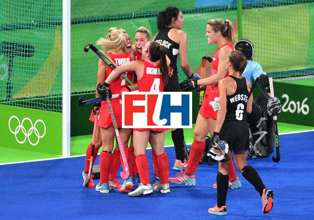 Britain's players celebrate the opening goal during the women's semifinal field hockey New Zealand vs Britain match of the Rio 2016 Olympics Games at the Olympic Hockey Centre in Rio de Janeiro on August 17, 2016. / AFP / Pascal GUYOT        (Photo credit should read PASCAL GUYOT/AFP/Getty Images)