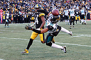 Jacksonville Jaguars cornerback Jalen Ramsey (20) leaps as he breaks up a deep fourth quarter pass intended for Pittsburgh Steelers wide receiver Antonio Brown (84) during the NFL 2018 AFC Divisional playoff football game against the Pittsburgh Steelers, Sunday, Jan. 14, 2018 in Pittsburgh. The Jaguars won the game 45-42. (©Paul Anthony Spinelli)