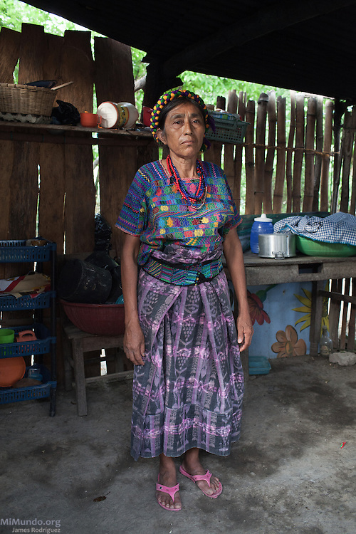 ntonia Osorio Sanchez, 62, survivor from Rio Negro, stands inside her kitchen. She hopes the Forensic Anthropology Foundation of Guatemala (FAFG) identifies and returns her sister-in-law Maria Tahuico Morales, thirty-five years old at the time of her killing or abduction during the May 14, 1982, Los Encuentros Massacre and possibly exhumed in 2012 from grave XV at the UN's CREOMPAZ training center, formerly Coban's Military Zone 21. During the massacre, Guatemalan soldiers and civil patrolmen killed 79 community members from Rio Negro who were hiding here after the previous two massacres of February and March of the same year. Eyewitnesses assured that at least 15 other community members were abducted in a helicopter. As of May 2016, CREOMPAZ's grave XV has rendered positive DNA matches of the remains of two victims abducted in the helicopter on such day. Antonia, who is the closest living relative to Maria Tahuico Morales, is not sure if she was killed in Los Encuentros or taken by Helicopter. Antonia lives in Pacux, the resettlement village outside Rabinal where the former Achi Mayan residents of Rio Negro were forcibly relocated after the massacres and destruction of their village and dozens more due to the flooding of the Chixoy river basin and construction of the Chixoy Hydro-electric project. Pacux, Rabinal, Baja Verapaz, Guatemala. May 20, 2016.