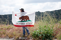 A local fan cheers from the roadside at Amgen Tour of California Women's Race empowered with SRAM 2019 - Stage 2, a 74 km road race from Ontario to Mount Baldy, United States on May 17, 2019. Photo by Sean Robinson/velofocus.com