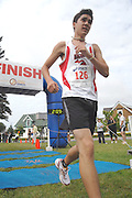 John Chase of Grosse Pointe, Michigan finishes his four mile run and takes third place in the male 15-19 age group of the inaugural Little Traverse Triathlon in Harbor Springs, Michigan.