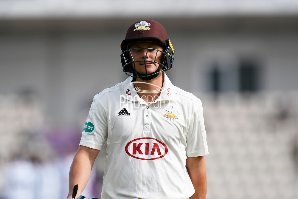 Wicket - Scott Borthwick of Surrey walks back to the pavilion after being dismissed by Fidel Edwards of Hampshire during the Specsavers County Champ Div 1 match between Hampshire County Cricket Club and Surrey County Cricket Club at the Ageas Bowl, Southampton, United Kingdom on 6 September 2017. Photo by Graham Hunt.