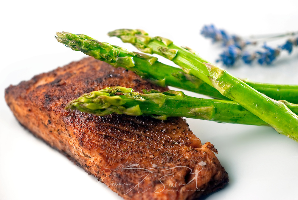 Pan-seared salmon is served with fresh, steamed asparagus and accented with a sprig of lavender. Salmon is rich in protein and Omega-3 fatty acids. (Photo by Carmen K. Sisson/Cloudybright)