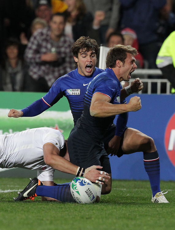 France's Vincent Clerc is congratulated by Alexis Palisson for scoring a try against England during quarter-final 2 match of the Rugby World Cup 2011, Eden Park, Auckland, New Zealand, Saturday, October 08, 2011.  Credit:SNPA / David Rowland