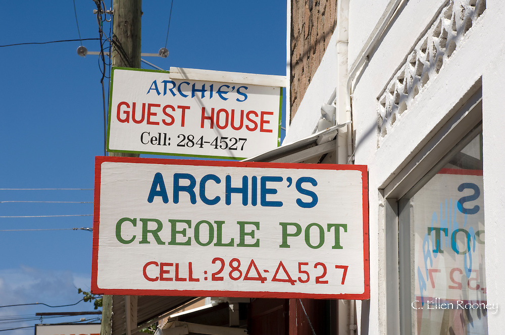 A sign for a local restaurant in Soufriere, St Lucia, The Windward Islands, The Caribbean