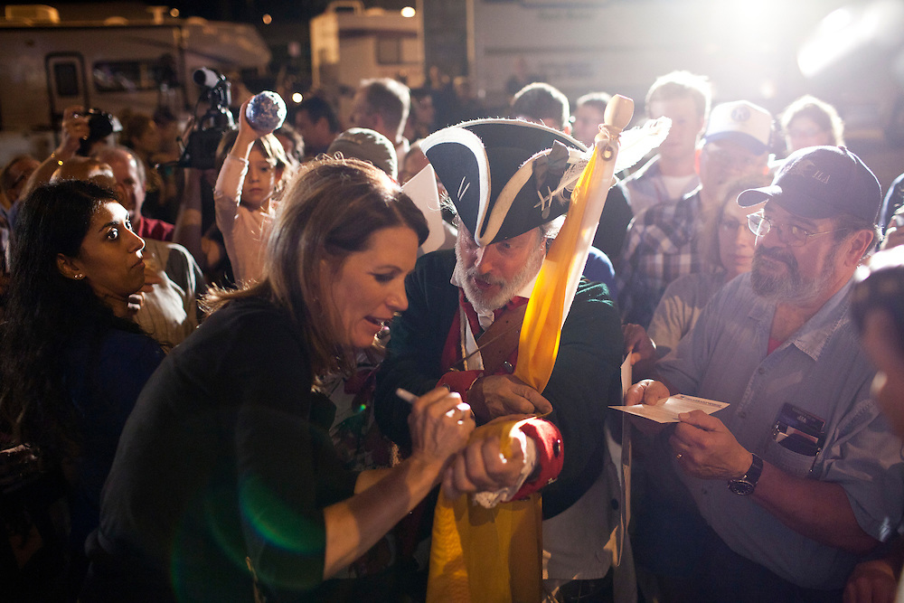 Republican presidential hopeful Michele Bachmann signs an autograph during a campaign stop on Friday, August 12, 2011 in Ames, IA.