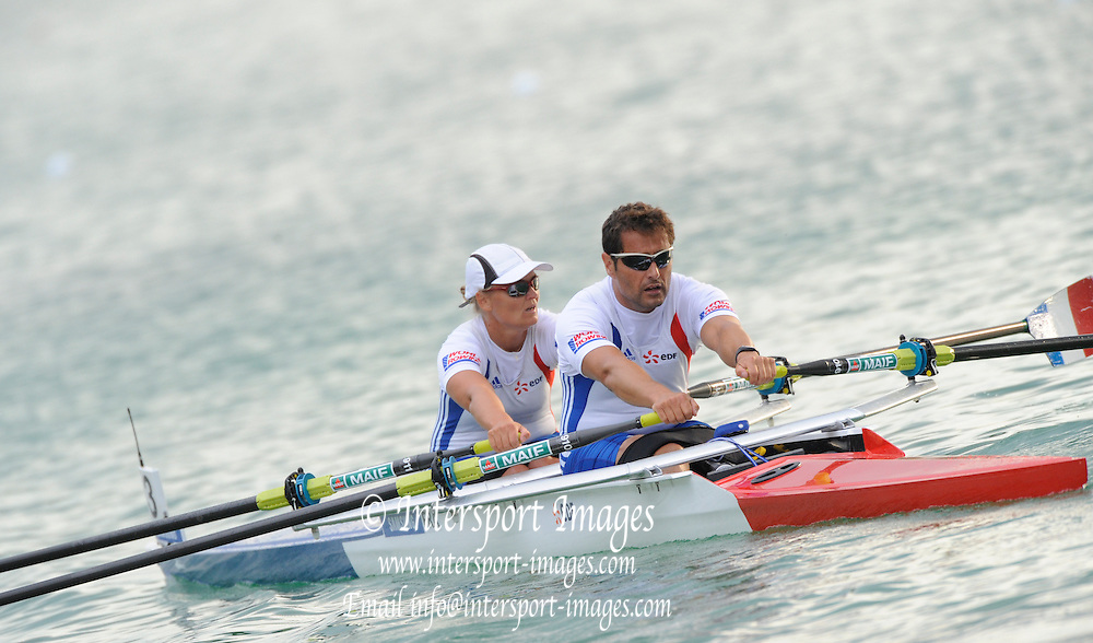 Munich, GERMANY, Adaptive Rowing,   Adaptive Heats FRA TAMix2x.  bow. Perle BOUGE and Staphane TARDIEU.  FISA world Cup Rd 1. Munich Olympic Rowing Course,  Thursday  26/05/2011  [Mandatory Credit Peter Spurrier/ Intersport Images]
