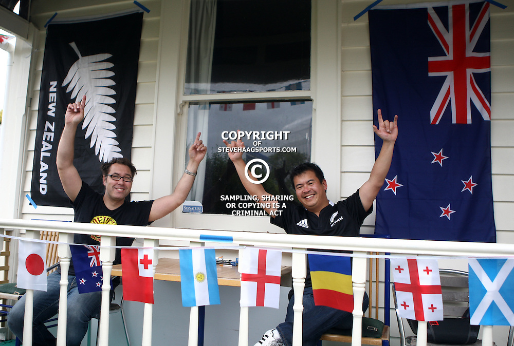 AUCKLAND, NEW ZEALAND - OCTOBER 23, 2 fans at home outside of Eden Park during the 2011 IRB Rugby World Cup final match between New Zealand and France at Eden Park on October 23, 2011 in Auckland, New Zealand<br /> Photo by Steve Haag / Gallo Images