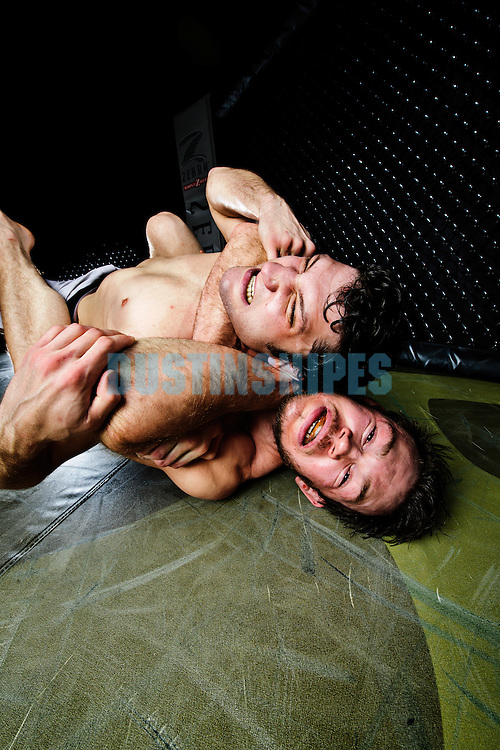 MMA Fighter Forrest Griffin grappling with a partner