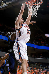Virginia Cavaliers forward Jason Cain (33) dunks against Longwood.  The Virginia Cavaliers Men's Basketball Team defeated Longwood University 90-49 at the John Paul Jones Arena in Charlottesville, VA on February 13, 2007.
