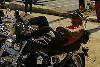 Harley Davidson biker William John Day from Florida enjoys an afternoon rest on his custom bike Thursday Aug. 28, 2003 Milwaukee. Thousands of Harley Davidson bikers from all over the world came to Wisconsin to help celebrate Harley Davidson 100th anniversary.   photo by Darren Hauck