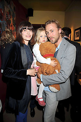 SAM & SUSIE PELLY and their daughter MELO at a party to celebrate the publication of Joth Shakerley's book 'Pregnant Women' held at 598a Kings Road, London SW6 on 20th May 2009.