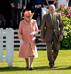 Queen Elizabeth II and The Duke of Edinburgh during the polo at the Guards Polo Club, Windsor Great Park, Egham, Surrey.