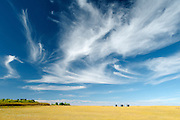 clouds and bales<br /> Wood Mountain <br /> Saskatchewan<br /> Canada