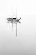 Two sailboats reflect in Shallowbag Bay on a foggy morning.