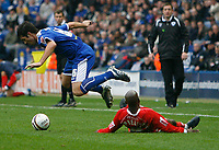 Photo: Steve Bond.<br /> Leicester City v Barnsley. Coca Cola Championship. 27/10/2007. Alan Sheehan (L) is sent flying by Jamal Campbell-Rice (ground) resulting in a booking for him