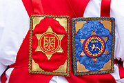 Emblem badge on sash worn by dancer during San Fermin Fiesta at Pamplona, Navarre, Northern Spain