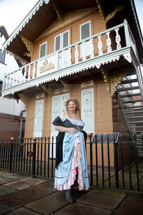 © London News Pictures. 07/02/2012.  Sandi Digby who runs tours around Rochester led by Dickensian characters including Nancy from Oliver Twist, outside the Swiss chalet, Rochester, Kent where Dickens used to write. Today celebrates the 200th birthday of Charles Dickens. Picture credit should read Manu Palomeque/LNP