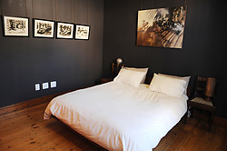 Cape Town - 180709 - Star Homes - 3 Regeant Road, Woodstock. He is a world renowned bronze sculptor and lives in Woodstock. Ferdi Dick is a world renowned bronze sculptor and lives in Woodstock. In pic is the bedroom    photographer - Tracey Adams/African News