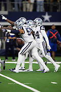 Dallas Cowboys outside linebacker Damien Wilson (57) and Cowboys cornerback Chidobe Awuzie (24) point and celebrate with Cowboys cornerback Jourdan Lewis (27) after Lewis intercepts a late fourth quarter pass and runs it back 7 yards to the New Orleans Saints 16 yard line on the game winning turnover as the time clocks winds down during the NFL week 13 regular season football game against the New Orleans Saints on Thursday, Nov. 29, 2018 in Arlington, Tex. The Cowboys won the game 13-10. (©Paul Anthony Spinelli)