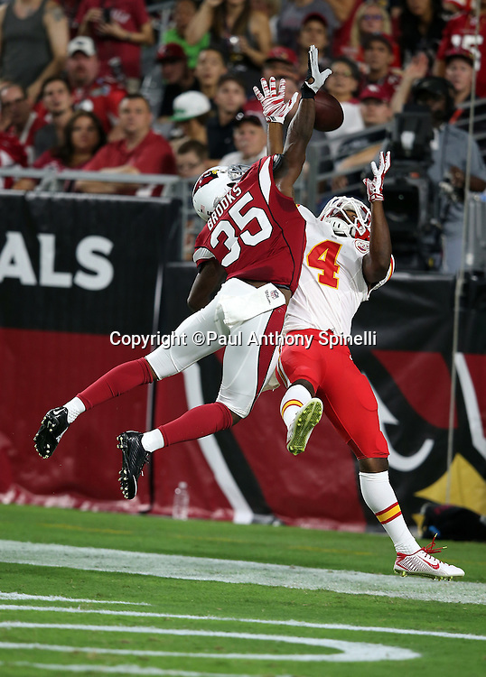 Arizona Cardinals defensive back Cariel Brooks (35) leaps and breaks up an end zone pass intended for Kansas City Chiefs wide receiver Da'Ron Brown (4) during the 2015 NFL preseason football game against the Kansas City Chiefs on Saturday, Aug. 15, 2015 in Glendale, Ariz. The Chiefs won the game 34-19. (©Paul Anthony Spinelli)