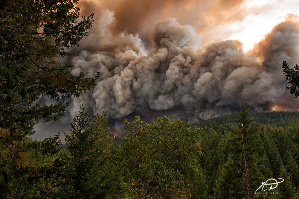 September 12, 2015 - Lake County, California, Firefighting aircraft in the center of the photo attacking the Valley Fire as it races through Boggs Mountain State Forest, observed from Loch Lomond. (Kim Ringeisen / Polaris)