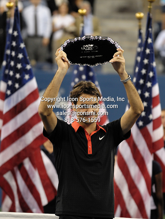 September 14, 2009: Roger Federer of Switzerland displaying his runner-up trophy after his loss to Argentina's Juan Martin Del Potro during the Men's Singles Final on Championship during Day 15 of the 2009 U.S. Open at the USTA Billie Jean King National Tennis Center in Flushing, Queens, New York City.<br />  ***** SWITZERLAND OUT *****