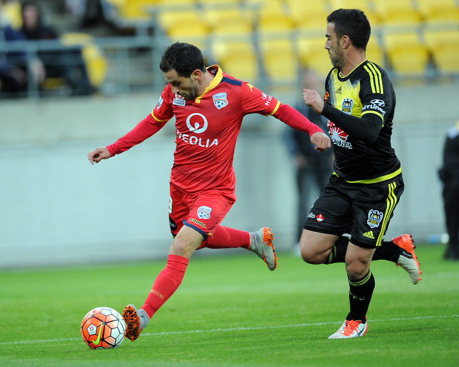 Adelaide United's Sergio Cirio, left, plays across in front of Phoenix's Manny Muscat in the A-League football match at Westpac Stadium, Wellington, New Zealand, Friday, November 13, 2015. Credit:SNPA / Ross Setford