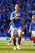 Nikola Katic of Rangers FC touches the club badge as he celebrates with the fans during the Ladbrokes Scottish Premiership match between Rangers and Celtic at Ibrox, Glasgow, Scotland on 12 May 2019.