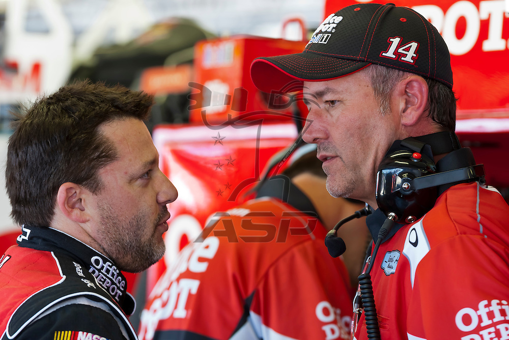 DARLINGTON, SC - MAY 11, 2012:  Tony Stewart (14) and Crew Chief, Steve Addington, talk during a practice session for the Bojangles Southern 500 at the Darlington Raceway in Darlington, SC.