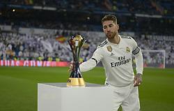 January 6, 2019 - Madrid, Madrid, Spain - Sergio Ramos picks up the FIFA Club World Cup won by Real Madrid to present his fans at the Santiago Bernabeu Stadium on January 6, 2018 in Madrid, Spain. (Credit Image: © Patricio Realpe/NurPhoto via ZUMA Press)