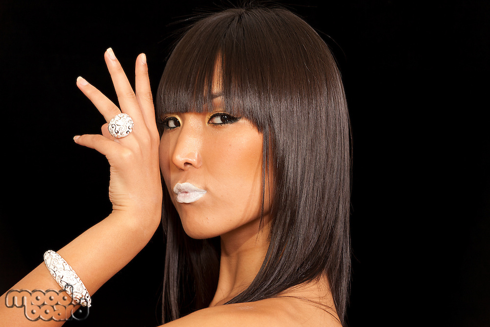 Asian woman posing on black background