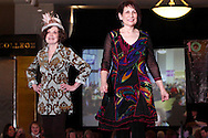 Wearing Fashions from Joli, models Ellen Cox (left) and Cheryl Abraham during A'Wear Affair, the Noble Circle fundraising fashion show, at Sinclair College's David H. Ponitz Center, Saturday, February 23, 2013.  Cox has been 8 1/2 years thriving beyond chronic lymphocytic leukemia.  Abraham  has been thriving two years and two months beyond breast cancer.