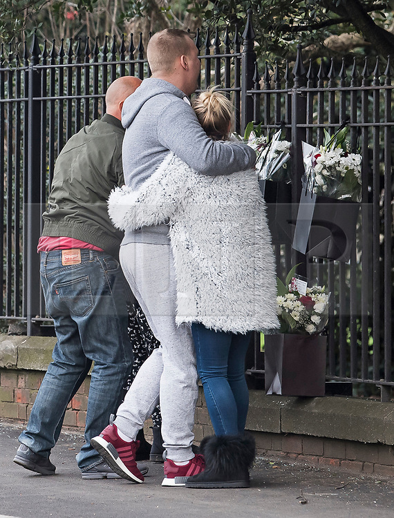 © Licensed to London News Pictures. 27/01/2018. London, UK. Grieving family members leave flowers at the scene where three teenage pedestrians were killed near a bus stop in Hayes, West London after a black Audi car is believed to have collided with them. Police were called to the incident, on Friday night at 20:41hrs, close to the M4 Junction 4 following reports of a serious road traffic collision. The victims died at the scene - are all believed to be teenage males, aged approximately 16. Photo credit: Ben Cawthra/LNP