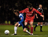 Photo: Jed Wee.<br />Oldham Athletic v Chasetown. The FA Cup. 16/11/2005.<br /><br />Oldham's Mark Hughes (L) tries to hold off Chasetown's Duncan Horler.