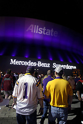 09 January 2012. New Orleans, Louisiana, USA.  <br /> BCS Championship. Fans arriving at the Superdome before the Crimson Tide rolls over LSU as Alabama trounces LSU 21-0 to take the Championship for the second year in a row. Students and fans pored onto Bourbon Street as the partying carried on late into the night. Alabama fans celebrated as LSU fans commiserated.<br /> Photos; Charlie Varley
