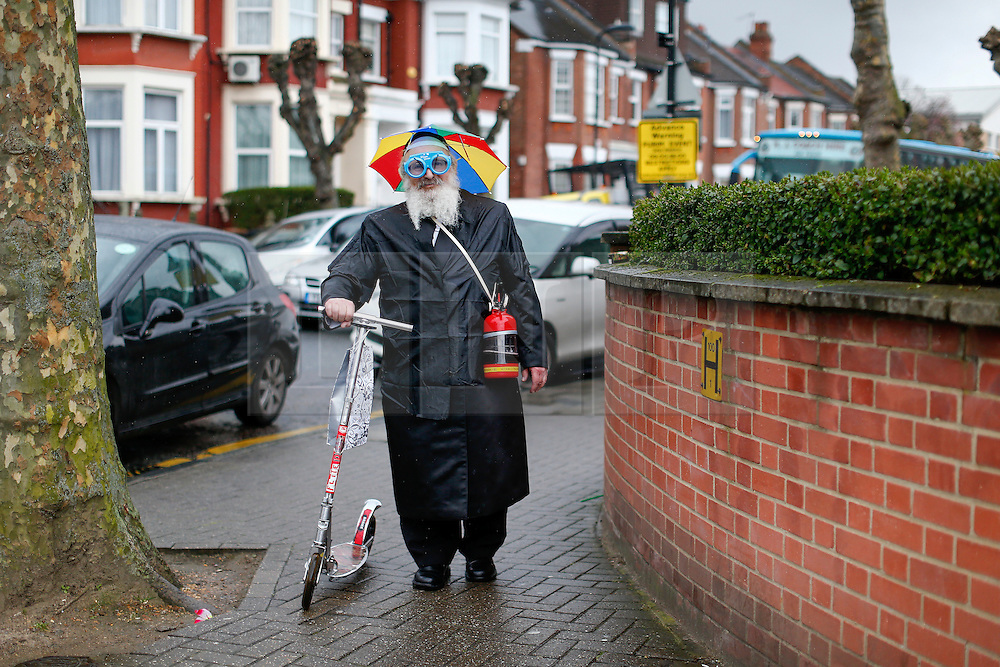 © London News Pictures. 24/03/2016.  An Orthodox Jewish man in fancy dress celebrates the festival of Purim in the streets of Stamford Hill in north London. Purim celebrates the miraculous salvation of the Jews from a genocidal plot in ancient Persia, an event documented in the Book of Esther. Traditionally the jewish community wear fancy dress and exchange reciprocal gifts of food and drink. Photo credit: Tolga Akmen/LNP
