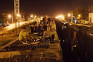 """TENOSIQUE, Tabasco.- On midnight, migrants get on board the railroad in Tenosique Tabasco.  This is the beginning of a long trip on """"La Bestia"""" (nickname of the train) where people can fall down and die or be maimed as they enter to the territory of the criminal group Los Zetas, dedicated to drug trafficking extortion and kidnapping. They should also pay an obligatory fee of around 100 and 300 USD to local criminal groups under threat of being thrown down. (Photo: Prometeo Lucero)"""