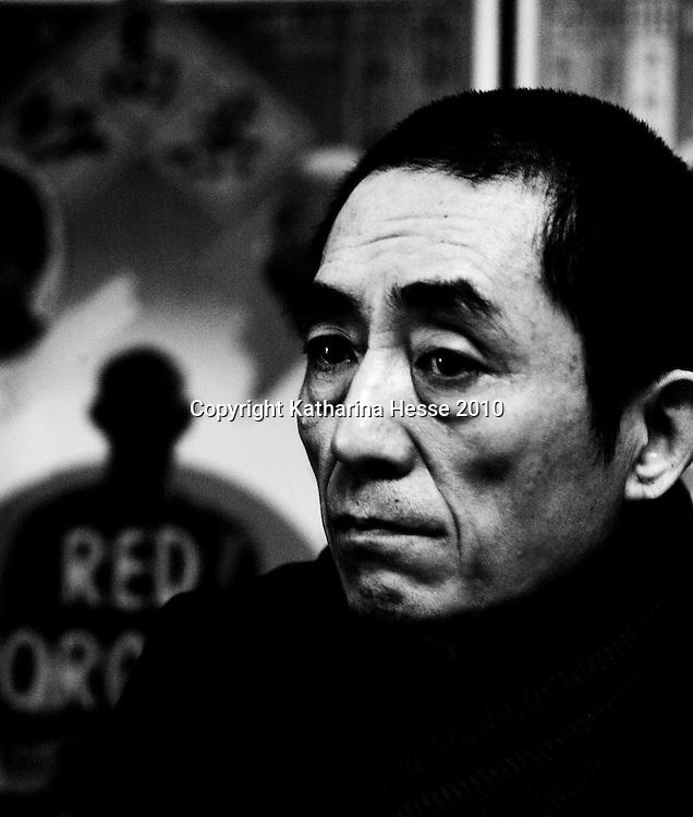 BEIJING, JANUARY 14, 2010: Film director Zhang Yimou in his office .