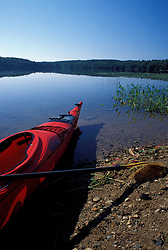 A kayak on the shores of Manning Lake in New Hampshire's Lakes Region.  Gilmanton Iron Works, NH