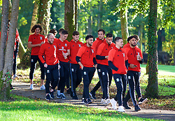 CARDIFF, WALES - Monday, October 9, 2017: Wales players during a pre-match walk at the Vale Resort ahead of the 2018 FIFA World Cup Qualifying Group D match between Wales and Republic of Ireland. Jonathan Williams, Tom Lawrence, Ben Davies, Neil Taylor, goalkeeper Daniel Ward, Hal Robson-Kanu, James Chester, captain Ashley Williams (Pic by David Rawcliffe/Propaganda)