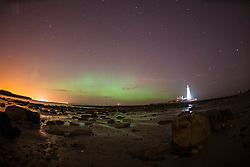 © Licensed to London News Pictures. 27/02/2014. Whitely Bay, England. The Aurora borealis AKA The Northern Lights, dance over St. Mary's Lighthouse in Whitely Bay just outside Newcastle, Tyne and Wear.. Photo credit : Reuben Tabne/LNP