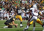 September 24, 2011: Iowa Hawkeyes kicker Mike Meyer (96) kicks an extra point from the hold of Iowa Hawkeyes quarterback John Wienke (14) during the second quarter of the game between the Iowa Hawkeyes and the Louisiana Monroe Warhawks at Kinnick Stadium in Iowa City, Iowa on Saturday, September 24, 2011. Iowa defeated Louisiana Monroe 45-17.