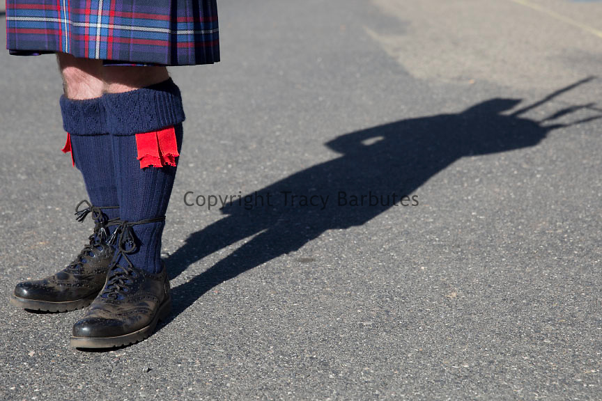 A bagpipers kilt and shadow at the Sonora Celtic Faire in Sonora, California - a gateway community to Yosemite National Park.