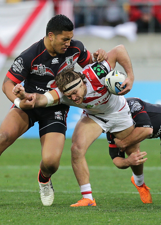 Mitch Rein of the Dragons is tackled by Albert Vete  and Nathan Friend of the New Zealand Warriors during their round 22 NRL match at Westpac  Stadium, Wellington on  Saturday, August 08, 2015. Credit: SNPA / David Rowland