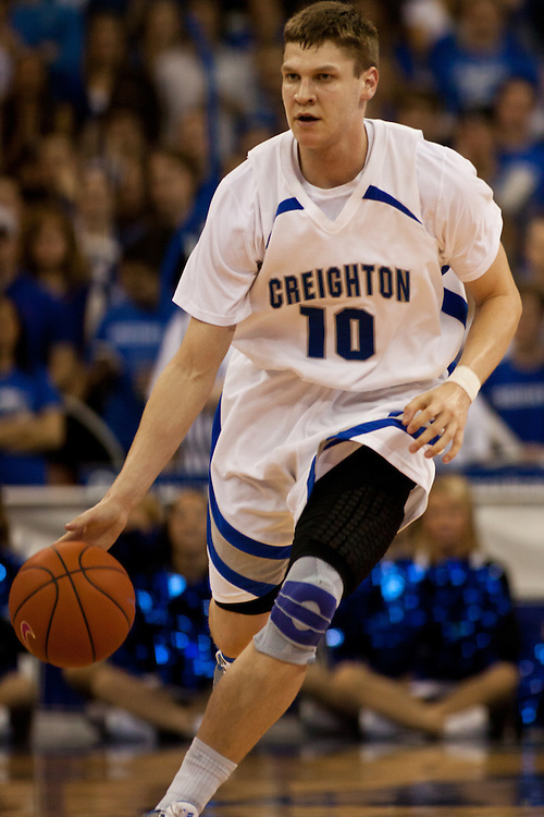 18 February 2012: Grant Gibbs #10 of the Creighton Bluejays brings the ball down court against the Long Beach State 49ers at the CenturyLink Center in Omaha, Nebraska. Creighton defeated Long Beach State 81 to 79.
